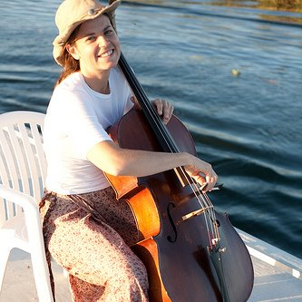 Ephemerisle: Holly plays cello on a houseboat